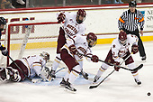 Joe Woll (BC - 31), David Cotton (BC - 17), Michael Kim (BC - 4), Austin Cangelosi (BC - 9) - The Boston College Eagles defeated the visiting UConn Huskies 2-1 on Tuesday, January 24, 2017, at Kelley Rink in Conte Forum in Chestnut Hill, Massachusetts.