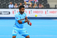 India's Manpreet Singh controls the ball during the Hockey World League Semi-Final 5-8th place match between Pakistan and India at the Olympic Park, London, England on 24 June 2017. Photo by Steve McCarthy.