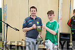 Tommy Cronin (Chairman of Coiste Na nÓg) presents the U14 Hurling A Feile Cup to Ballyduff's captain Dan O'Sullivan.