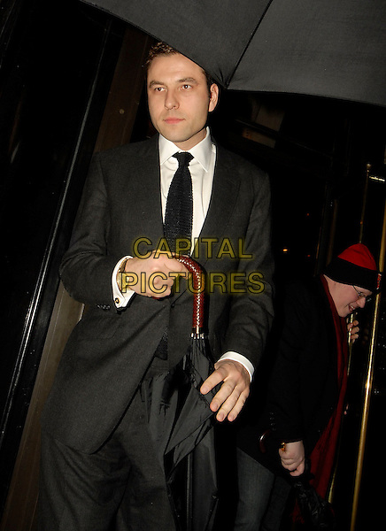 DAVID WALLIAMS & MATT LUCAS.Leaving The Wolseley, London, England, April 9th 2006..half length umbrella raining black suit tie red hat glasses hiding.Ref: SW.www.capitalpictures.com.sales@capitalpictures.com.©Stephen Walters/Capital Pictures.