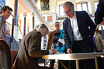 Anne Tyler signing a book for Robert Harris at the Sheldonian Theatre during the Sunday Times Oxford Literary Festival, UK, 24 March - 1 April 2012. ..PHOTO COPYRIGHT GRAHAM HARRISON .graham@grahamharrison.com.+44 (0) 7974 357 117.Moral rights asserted.