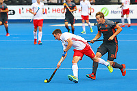 England's Harry Martin and Netherlands Floris Wortelboer compete for the ball during the Hockey World League Semi-Final match between England and Netherlands at the Olympic Park, London, England on 24 June 2017. Photo by Steve McCarthy.