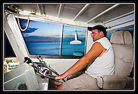 Josh Niklaus pilots The Captain R & R out to sea just after dawn to check the contents of his first lobster traps of the 2006 season.  Niklaus, and other captains, are hoping for a sizable catch to recoup their losses from the hurricane-wrecked seasons of 2004 and 2005.