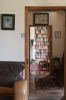 The book-lined study seen from the open door of the living room