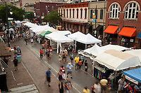 The Pecan Street Festival is a free, bi-annual juried arts and crafts festival held on 6th Street in Austin, Texas.  The show features artisans from all over the United States who display and sell homemade art and craftwork. Festival goers can find paintings, sculpture, woodwork, candles, jewelry, cowboy hats, home decor, games, and other useful and whimsical household items.