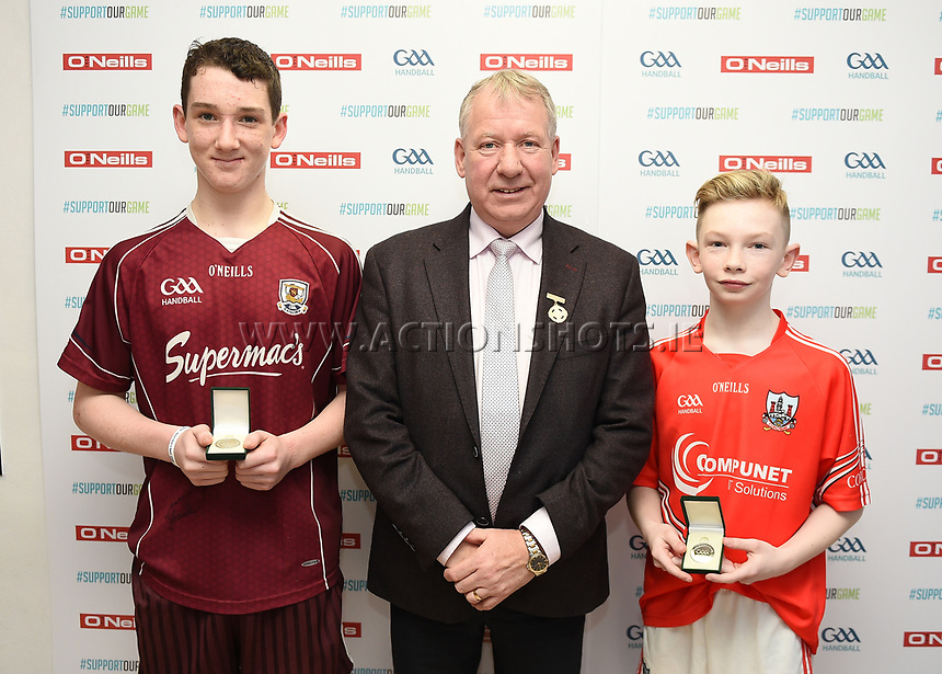 19/03/2018; 40x20 All Ireland Juvenile Championships Finals 2018; Kingscourt, Co Cavan;<br /> Boys Under-14 Singles; Galway (Mikey Kelly) v Cork (Hayden Supple)<br /> Mikey Kelly and Hayden Supple with GAA Handball President Joe Masterson<br /> Photo Credit: actionshots.ie/Tommy Grealy