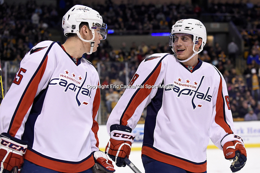 Tuesday, January 5, 2015: Washington Capitals left wing Andre Burakovsky (65) (left) and defenseman Nate Schmidt (88) (right) talk during the National Hockey League game between the Washington Capitals and the Boston Bruins, held at TD Garden, in Boston, Massachusetts. Washington beats Boston 3-2 in regulation time. Eric Canha/CSM
