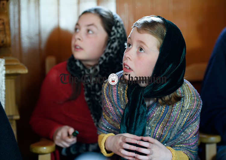 Sisters Leila and Emma Malone Smith look on during a cultural visit to The Rambling House in Kilmurry Mc Mahon by pupils of Labasheeda National School. Photograph by John Kelly.