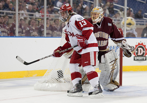 10 April 2010: Wisconsin Forward Aaron Bendickson (#13) and Boston College Goaltender John Muse (#1) look to the corner for the puck on game action between the Wisconsin Badgers and the Boston College Eagles at Ford Field in Detroit, Michigan.  Boston College defeated Wisconsin 5-0. Mandatory Credit: John Mersits / Southcreek Global