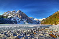Frozen Lake Louise in morning sun in Banff National Park, Alberta, Canada