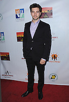 "WEST HOLLYWOOD, CA - APRIL 14:  Roberto Aguire at the ""Road to Hope"" charity event at Bootsy Bellows on April 14, 2014 in West Hollywood, California. (Photo by PGSK/Starlitepics.)"
