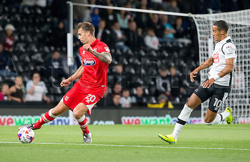 09.08.2016. iPro Stadium, Derby, England. Football League Cup 1st Round. Derby versus Grimsby Town. Grismby Town defender Andrew Boyce keeps possession of the ball whilst under pressure from Derby County midfielder Tom Ince.