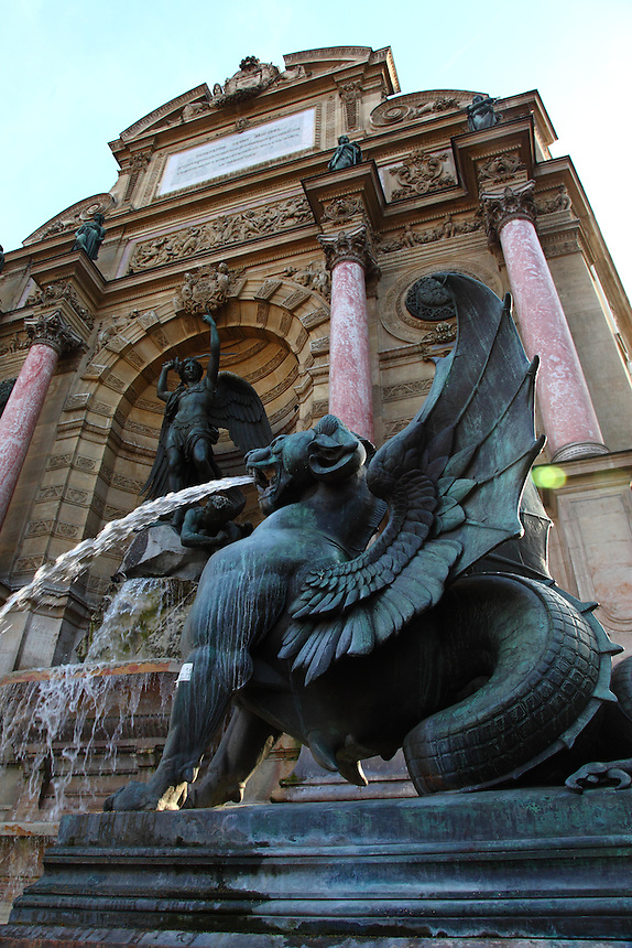 A lateral view of the fountain of Saint Michel in Paris, with one of the dragons and its beautiful spurt of water in the foreground. Digitally Improved Photo.