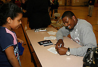 David Oliver signing autograph for a young fan at the Tobin Community Center on Friday, February 22, 2008.Photo by Errol Anderson,The Sporting Image.