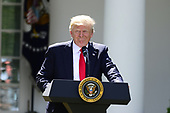 United States President Donald J. Trump makes a statement  regarding the Paris Accord in the Rose Garden of the White House in Washington, DC on Thursday, June 1, 2017.  The President announced the US will withdraw from the accord.<br /> Credit: Ron Sachs / CNP