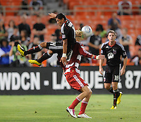 DC United midfielder Andy Najar (14) jumps against FC Dallas midfielder Brek Shea (20).  FC. Dallas defeated DC United 3-1 at RFK Stadium, Saturday August 14, 2010.