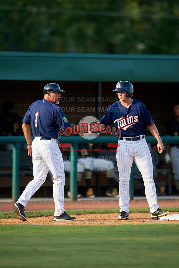 Elizabethton Twins left fielder Tyler Webb (30) is congratulated by batting coach Jeff Reed (1) during a game against the Bristol Pirates on July 28, 2018 at Joe O'Brien Field in Elizabethton, Tennessee.  Elizabethton defeated Bristol 5-0.  (Mike Janes/Four Seam Images)