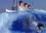 6 Feb 2000: Jeff Hubbard rides a 10-foot wave in the view of the Queen Mary at the Swatch Wave Tour in Long Beach, California. Mandatory Credit: Donald Miralle/Getty Images