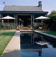 The lap-pool dominates this small garden and is overlooked from the veranda of this contemporary cottage