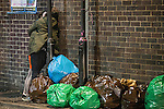 "© Joel Goodman - 07973 332324 . Manchester , UK . 05/04/2015 . A couple embrace alongside bagged rubbish, in Manchester's "" Gay Village "" . Revellers on a Saturday night out during the Easter Bank Holiday weekend . Photo credit : Joel Goodman"