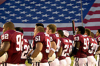 The team comes out for the national anthem in response to the tragedy that struck the nation on Sep. 11, 2001 during Stanford's 51-28 victory over ASU on September 22, 2001 at Stanford Stadium.<br />Photo credit mandatory: Gonzalesphoto.com