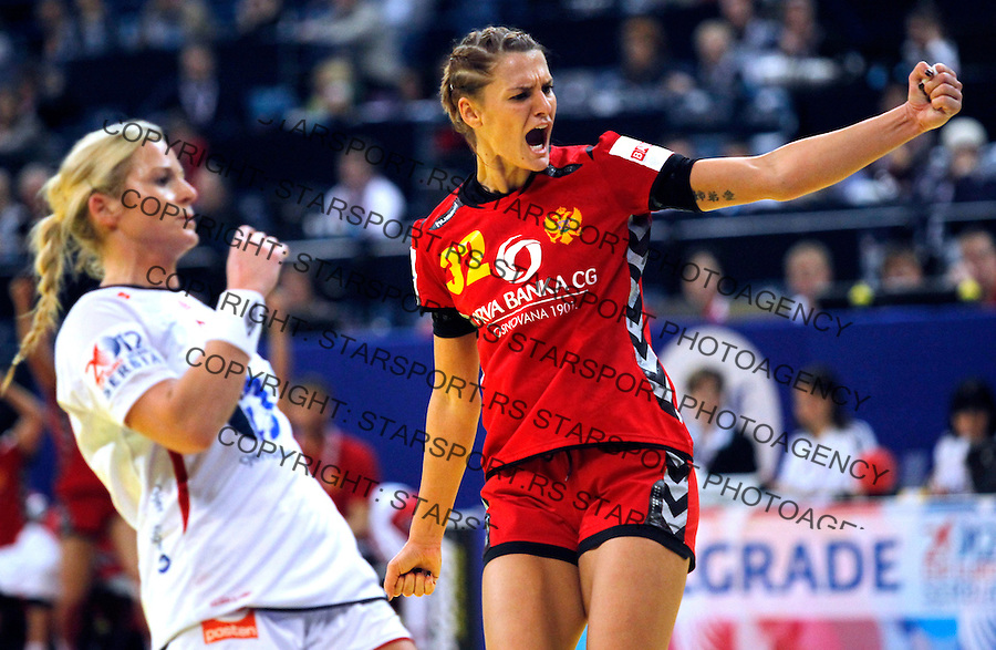 BELGRADE, SERBIA - DECEMBER 16: Katarina Bulatovic of Montenegro (R) celebrates the goal near Ida Alstad (L) of Norway during the Women's European Handball Championship 2012 gold medal match between Norway and Montenegro at Arena Hall on December 16, 2012 in Belgrade, Serbia. (Photo by Srdjan Stevanovic/Getty Images)
