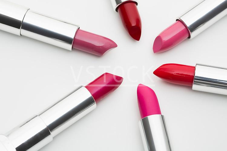 Various lipsticks on white background