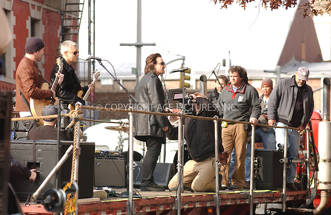 "WWW.ACEPIXS.COM . . . . . ....NEW YORK, NOVEMBER 22, 2003....Adam Clayton,The Edge, Larry Mullan, and Bono filming a promotional video for the new U2 album ""How to Dismantle an Atomic Bomb"" in NYC.....Please byline: ACE006 - ACE PICTURES.. . . . . . ..Ace Pictures, Inc:  ..Alecsey Boldeskul (646) 267-6913 ..Philip Vaughan (646) 769-0430..e-mail: info@acepixs.com..web: http://www.acepixs.com"