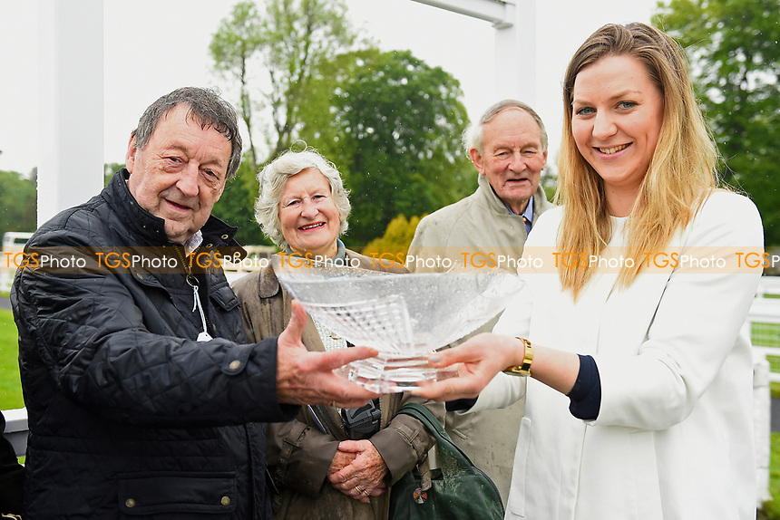 Connections of Intimately receive their trophy during Afternoon Racing at Salisbury Racecourse on 18th May 2017