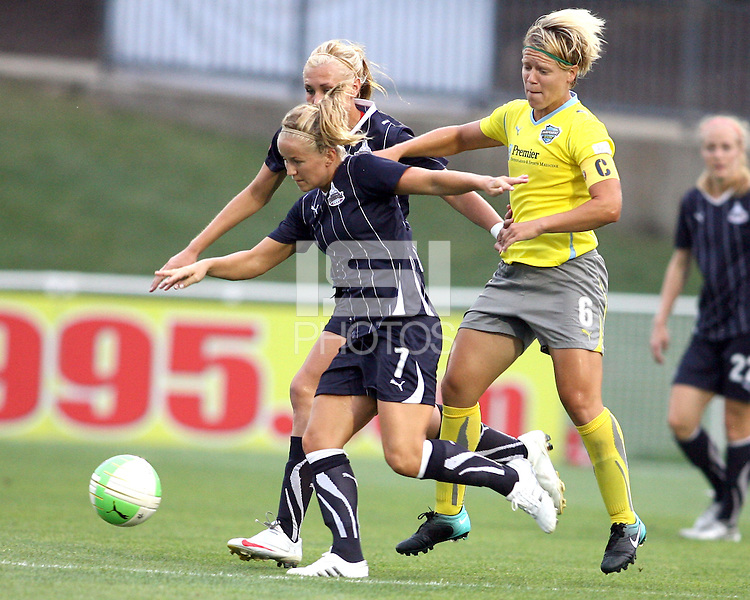 Lene Mykjvelan #7 and Allie Long #9 of the Washington Freedom moves away from Lori Lindsey #6 of the Philadelphia Independence during a WPS match on August 4 2010 at the Maryland Soccerplex, in Boyds, Maryland.Freedom won 2-0.
