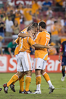 Houston Dynamo forward Brian Mullan (9), midfielder Geoff Cameron (20), and midfielder Brad Davis (11) celebrate a Brian Mullan goal in the 54th minute.  Houston Dynamo defeated Atlante FC 4-0  during the group stage of the Superliga 2008 tournament at Robertson Stadium in Houston, TX on July 12, 2008.