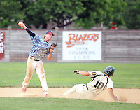 Doylestown second baseman Kyle Feasby throws to first after forcing out Pennridge's Sean McLeod #10 in the fifth inning at Quakertown Memorial Park Sunday July 12, 2015 in Quakertown, Pennsylvania. Pennridge defeated Doylestown 17-2 in 6 innings due to a mercy rule. (Photo by William Thomas Cain)