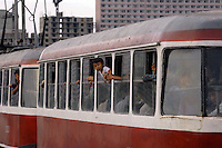 A packed trolley bus on the streets of Pyongyang, North Korea.