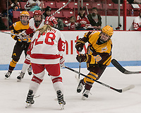 Boston, Massachusetts - December 10, 2016: NCAA Division I. In overtime, Boston University (white) defeated University of Minnesota (maroon), 6-5 in women's hockey, at Walter Brown Arena.