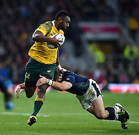 Tevita Kuridrani of Australia is tackled. Rugby World Cup Quarter Final between Australia and Scotland on October 18, 2015 at Twickenham Stadium in London, England. Photo by: Patrick Khachfe / Onside Images