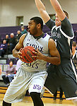 SIOUX FALLS, SD - DECEMBER 8:  Daniel Hurtt #15 from the University of Sioux Falls battles for position with Mitch Weg #5 from Southwest Minnesota State Tuesday night at the Stewart Center. (Photo by Dave Eggen/Inertia)