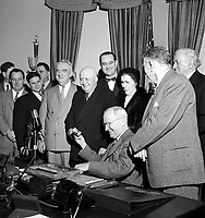 Sam Rayburn, Speaker of the House of Representatives, receives gavel from President Truman for having served longer as Speaker than anyone in history. Gavel made of wood that was used to rebuild White House in 1817 after the British burned it. White House, 1952. CREDIT: JOHN G. ZIMMERMAN