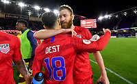 ORLANDO, FL - NOVEMBER 15: Tim Ream #13 and Sergino Dest #18 of the United States celebrate during a game between Canada and USMNT at Exploria Stadium on November 15, 2019 in Orlando, Florida.
