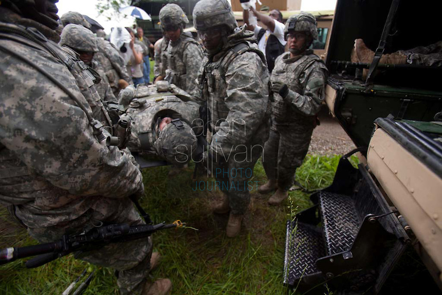 Members of the Georgia Army National Guard's 48th Brigade, 148th Brigade Support Battalion, train in an attack and medical evacuation scenario during a media visit day at Camp Atterbury, Indiana on Wednesday, June 3, 2009. The brigade's upcoming overseas mission is to train the Afghan National Army and Police forces.