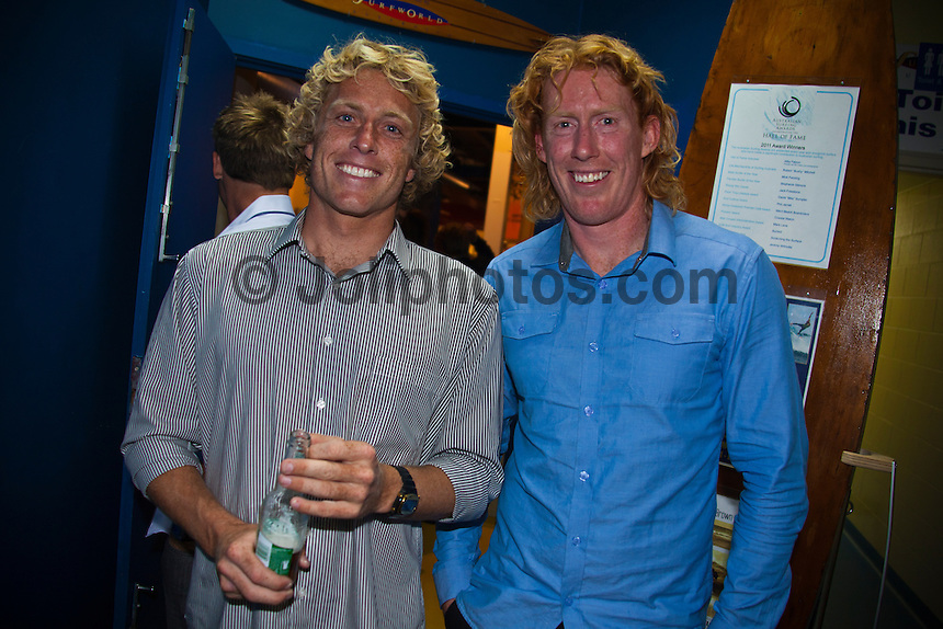 BELLS BEACH, Victoria/Australia (Friday, April 22, 2011) - Adam Robertson (AUS) with Gellong Football captain Cameron Ling (AUS).  Last night celebrated 50-years of competitive surfing at the Rip Curl Pro and the Bells Beach Easter Rally at Bells Beach, Australia's ancestral home of surfing. To honour this milestone a 50 th Anniversary Surfers Ball was held at Surfworld in Torquay, with some of surfing's biggest names in attendance...Iconic names of the sport included Nat Young (AUS), four times World Surfing Champion Mark Richards(AUS), seven times World Surfing Champion Layne Beachley (AUS), two  times World Surfing Champion Tom Carroll (AUS), Damien Hardman (AUS), four times World Surfing Champion Stephanie Gilmore (AUS), former World Surfing Champion Mark Occhilupo (AUS), trhee times World Surfing Champion Tom Curren (USA) and  current ten times World Surfing Champion Kelly Slater  (USA) were on hand to pay homage to the longest running surfing event in the world. . - Photo: joliphotos.com