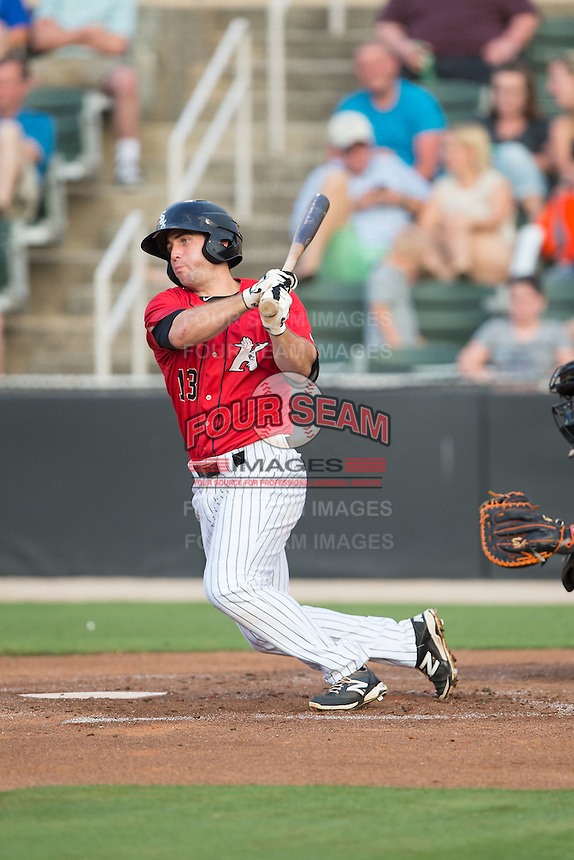 Ryan Leonards (13) of the Kannapolis Intimidators follows through on his swing against the Delmarva Shorebirds at CMC-Northeast Stadium on June 6, 2015 in Kannapolis, North Carolina.  The Shorebirds defeated the Intimidators 7-2.  (Brian Westerholt/Four Seam Images)