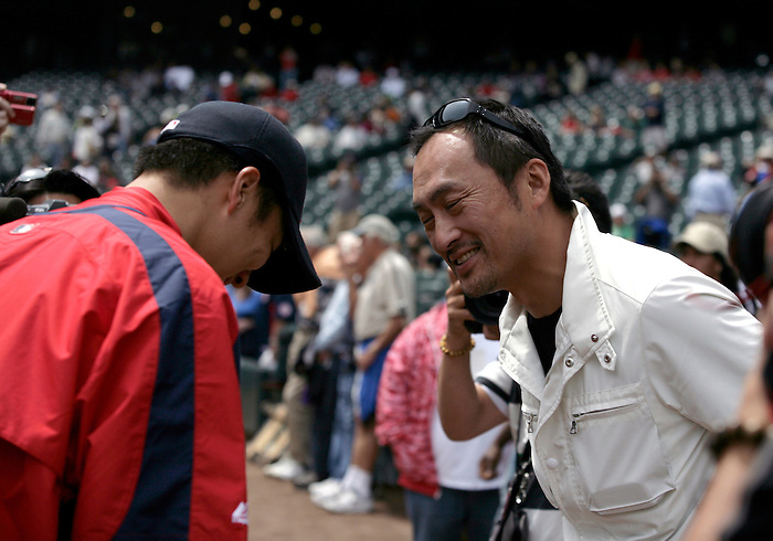 27 June 2007: Japanese actor Ken Watanabe (The Last Samurai, Letters from Iwo Jima)greets Red Sox Pitcher and fellow countryman Daisuke Matsuzaka before the Seattle Mariners vs Boston Red Sox game at Safeco Park in Seattle, Washington.
