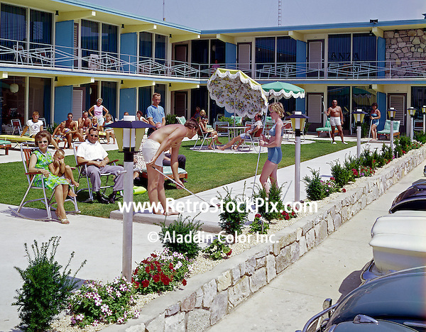 Bonanza Motel Wildwood, NJ. Families playing Shuffleboard and lounge on the patio.