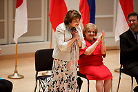Jury Member Skaila Kanga of the United Kingdom stands for recognition during the opening ceremony of the 11th USA International Harp Competition at Indiana University in Bloomington, Indiana on Wednesday, July 3, 2019. (Photo by James Brosher)