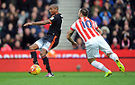 Ashley Young of Manchester United is challenged by Marko Arnautovic of Stoke City<br /> - Barclays Premier League - Stoke City vs Manchester United - Britannia Stadium - Stoke on Trent - England - 26th December 2015 - Pic Robin Parker/Sportimage