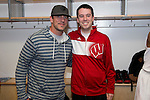 Wisconsin Badgers student manager Marc VandeWettering with Green Bay Packers quarterback Aaron Rodgers after  a regional semifinal NCAA college basketball tournament game against the Baylor Bears Thursday, March 27, 2014 in Anaheim, California. The Badgers won 69-52. (Photo by David Stluka)