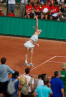Caroline Wozniacki (DEN) and Daniela Hantuchova (SVK) against Tatjana Malek and Andrea Petkovic in the first round of the women's doubles. Wozniacki and Hantuchiva beat Malek and Petkovic 7-5 7-6..Tennis - French Open - Day 3 - Tue 25 May 2010 - Roland Garros - Paris - France..© FREY - AMN Images, 1st Floor, Barry House, 20-22 Worple Road, London. SW19 4DH - Tel: +44 (0) 208 947 0117 - contact@advantagemedianet.com - www.photoshelter.com/c/amnimages
