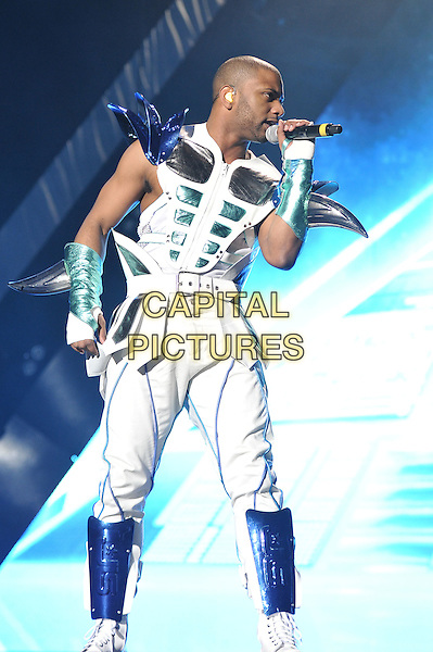 "Jonathan ""JB"" Gill of JLS .performing live in concert, O2 Arena, Greenwich, London, England, UK, .23rd March 2012..full length boy band group on stage gig music full length white costume silver shoulder pads futuristic microphone singing .CAP/MAR.© Martin Harris/Capital Pictures."