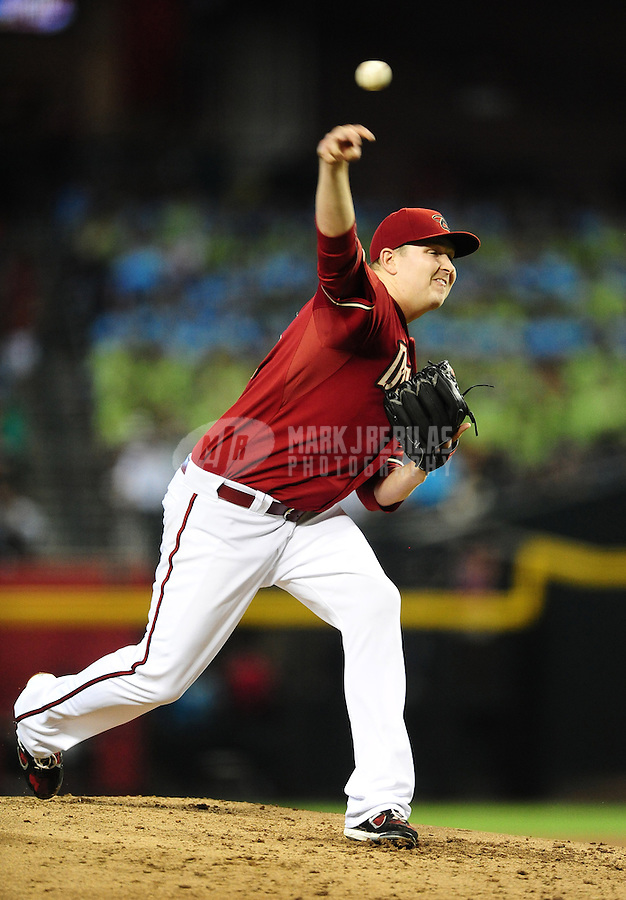 Jun. 20, 2012; Phoenix, AZ, USA; Arizona Diamondbacks pitcher Trevor Cahill throws in the third inning against the Seattle Mariners at Chase Field.  Mandatory Credit: Mark J. Rebilas-