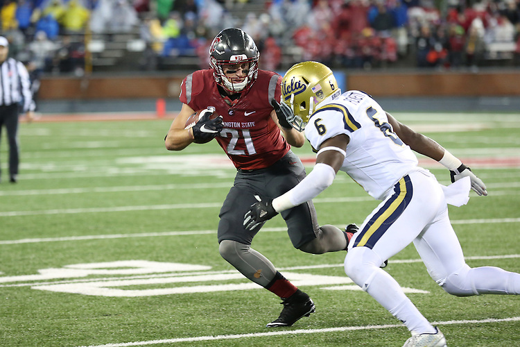 River Cracraft, Washington State University receiver, prepares to stiff arm a defender during the Cougars Pac-12 Conference victory over the UCLA Bruins, 27-21, on October 15, 2016, at Martin Stadium in Pullman, Washington.
